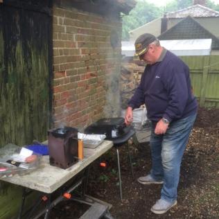 John BBQing burgers