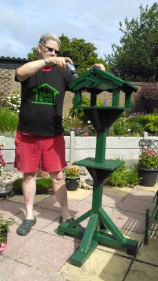 Karl finishes repair to bird table.