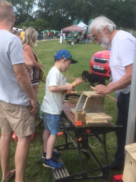 John helping young lad to build his box.