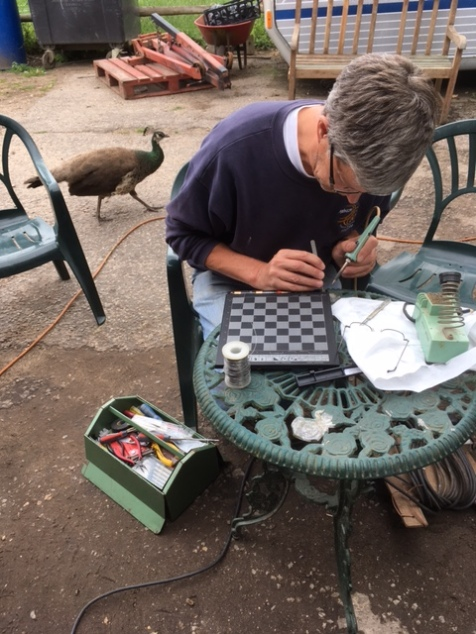 Checkmate!-Pete repairs an electronic chessboard