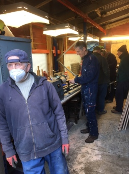 Bury shedders in metal workshop.