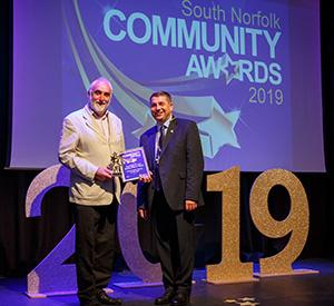 John receives our award