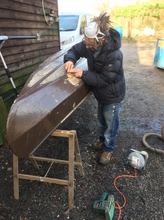 Canoe repair in progress