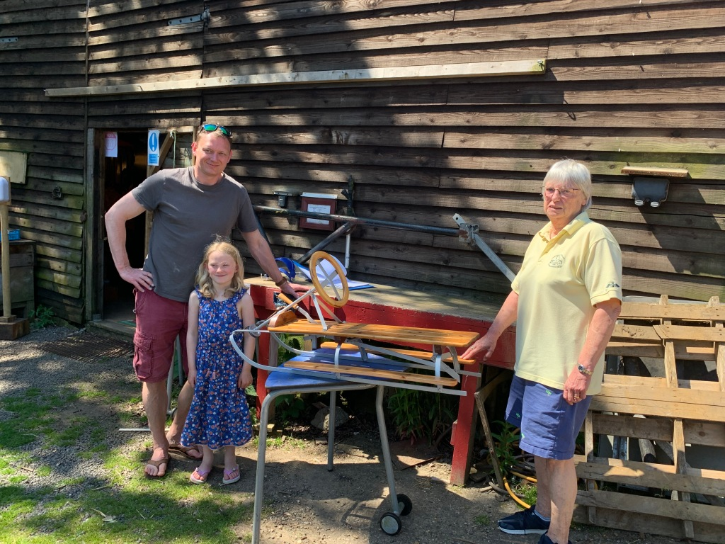 Handing over the Sled The owner, her son and granddaughter - the next pilot!